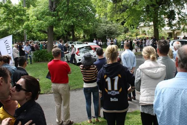 Celebrating with a smooch bottom left! 10 Russell Street sells under the hammer $5,350,000